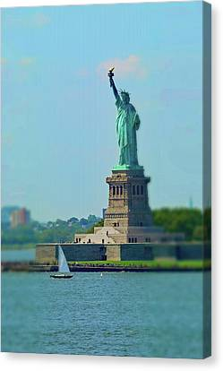 Big Statue, Little Boat Canvas Print by Sandy Taylor
