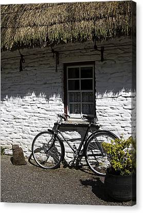 Bike At The Window County Clare Ireland Canvas Print by Teresa Mucha