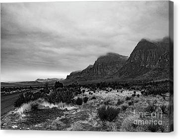 Black And White  Red Rock Storm Canvas Print by Oscar Bahena