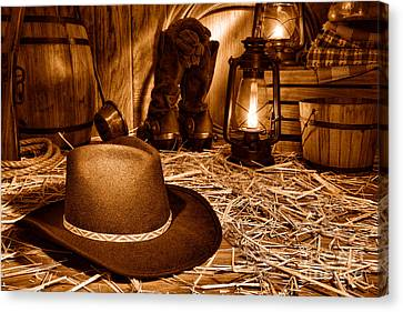 Black Cowboy Hat In An Old Barn - Sepia Canvas Print by Olivier Le Queinec