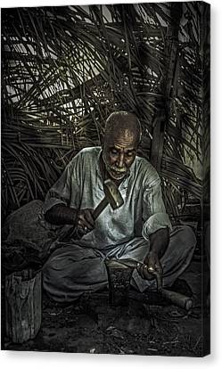 Blacksmith At Work Canvas Print by Zak Kz