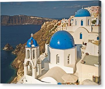 Blue Churches Of Santorini Canvas Print by Jim Chamberlain