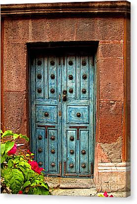 Blue Door With Bougainvilleas Canvas Print by Mexicolors Art Photography
