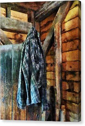 Blue Plaid Jacket In Cabin Canvas Print by Susan Savad