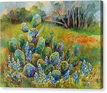 Bluebonnets And Cactus Canvas Print by Hailey E Herrera