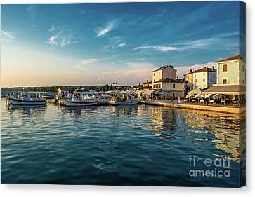 Boats In Harbor In Croatia At Sunset Canvas Print by Andreas Berthold