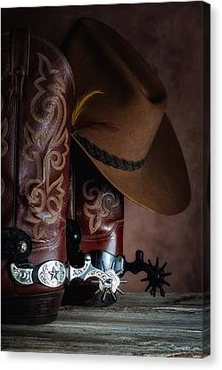 Boots And Spurs Canvas Print by Tom Mc Nemar