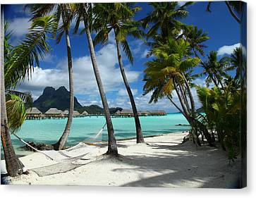 Bora Bora Beach Hammock Canvas Print by Owen Ashurst