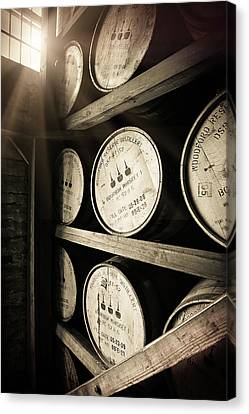 Bourbon Barrels By Window Light Canvas Print by Karen Varnas