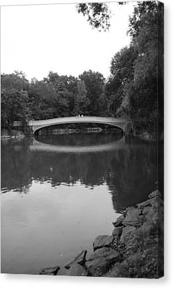 Bow Bridge And The Lake Canvas Print by Christopher Kirby