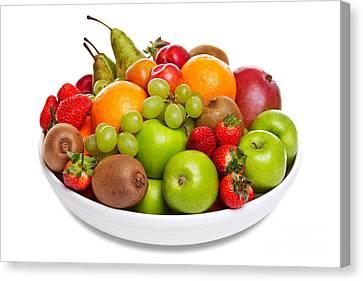 Bowl Of Fresh Fruit Isolated On White Canvas Print by Richard Thomas