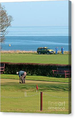 Bowls And Coastguards Canvas Print by David  Hollingworth