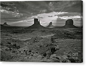 Breaking Light At Monument Valley - Black And White Canvas Print by Brian Stamm