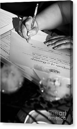 Bride Signing Name On Marriage Register Contract Canvas Print by Jorgo Photography - Wall Art Gallery