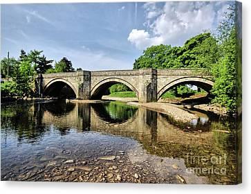 Bridge At Grinton Canvas Print by Stephen Smith