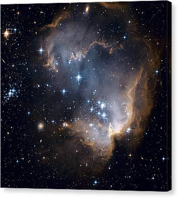 Bright Blue Newborn Stars Blast A Hole Canvas Print by ESA and nASA