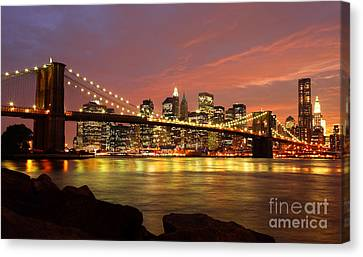 Brooklyn Bridge At Night Canvas Print by Holger Ostwald