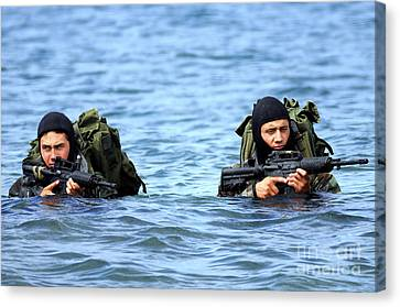 Buds Students Wade Ashore During An Canvas Print by Stocktrek Images