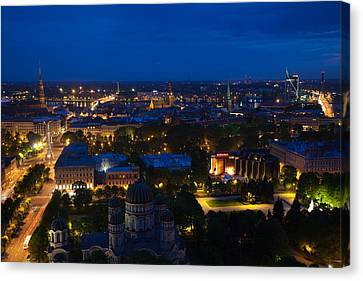Buildings Lit Up At Dusk, Vecriga, Old Canvas Print by Panoramic Images