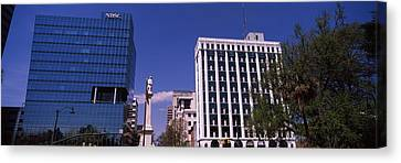 Buildings Near Confederate Monument Canvas Print by Panoramic Images