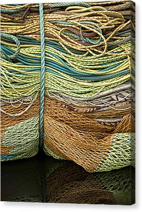 Bundle Of Fishing Nets And Ropes Canvas Print by Carol Leigh