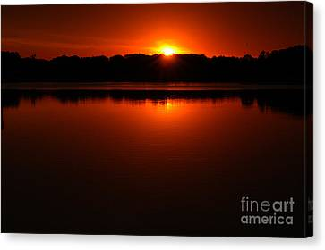 Burnt Orange Sunset On Water Canvas Print by Clayton Bruster