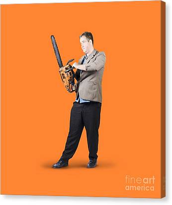 Businessman Holding Portable Chainsaw Canvas Print by Jorgo Photography - Wall Art Gallery