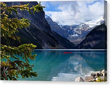 Canoe On Lake Louise Canvas Print by Larry Ricker