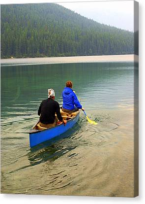 Canoeing Glacier Park Canvas Print by Marty Koch