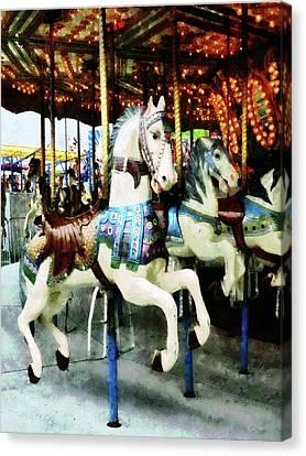 Carousel Horses Canvas Print by Susan Savad