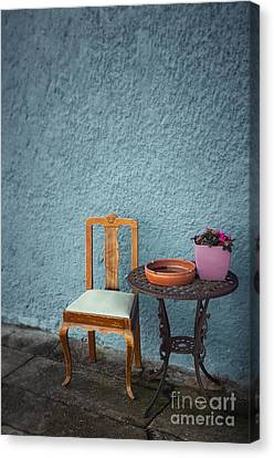 Chair And Iron Table Canvas Print by Carlos Caetano