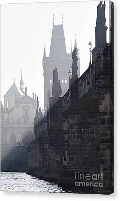 Charles Bridge In The Early Morning Fog Canvas Print by Michal Boubin