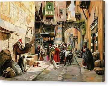 Chiacchiere Al Mercato Canvas Print by Guido Borelli