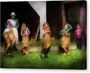 Children - The Sack Race  Canvas Print by Mike Savad