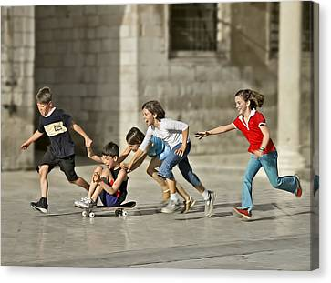 Children Playing In Dubrovnik Canvas Print by Herbert A. Franke