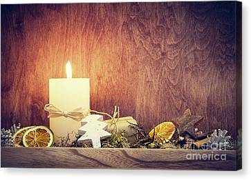 Chistmas Decoration With Candle Glowing On Wooden Wall Background Canvas Print by Michal Bednarek