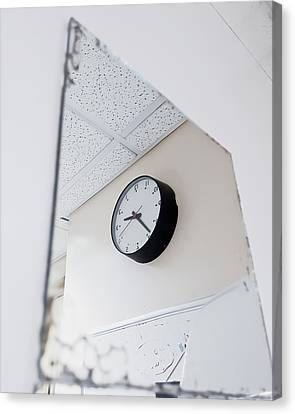 Clock In The Mirror Canvas Print by Tom Gowanlock
