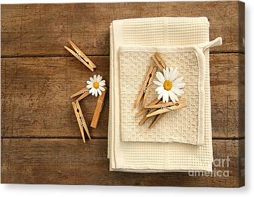 Close-pins And Dish Towels On Old Table  Canvas Print by Sandra Cunningham