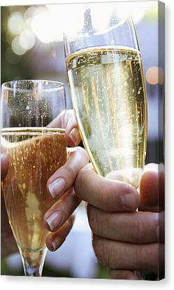 Close-up Of Champagne Flutes Canvas Print by Gillham Studios