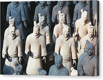 Close Up View Of Terracotta Warriors Canvas Print by George Oze