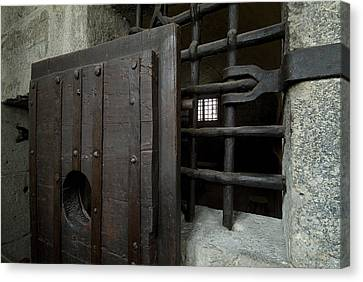 Close View Of Heavy Door To A Cell Canvas Print by Todd Gipstein