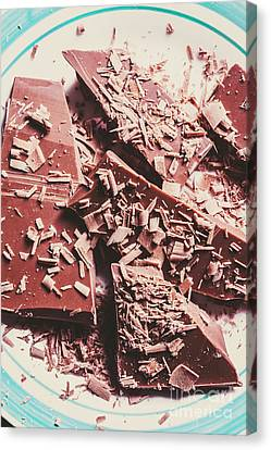 Closeup Of Chocolate Pieces And Shavings On Plate Canvas Print by Jorgo Photography - Wall Art Gallery