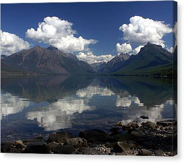 Clouds On The Water Canvas Print by Marty Koch