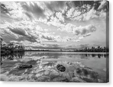 Clouds Touching The Water Canvas Print by Jon Glaser