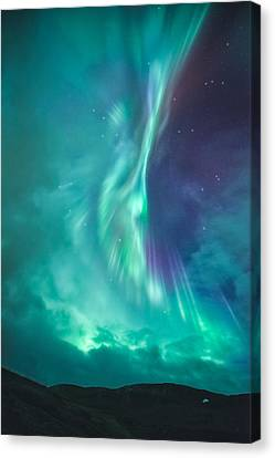 Clouds Vs Aurorae Canvas Print by Tor-Ivar Naess