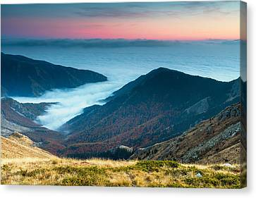 Coast In The Clouds Canvas Print by Evgeni Dinev