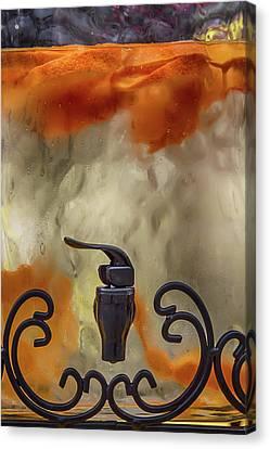 Cold Orange Drink Canvas Print by John Haldane