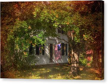 Colonial Home With Flag In Autumn Canvas Print by Joann Vitali