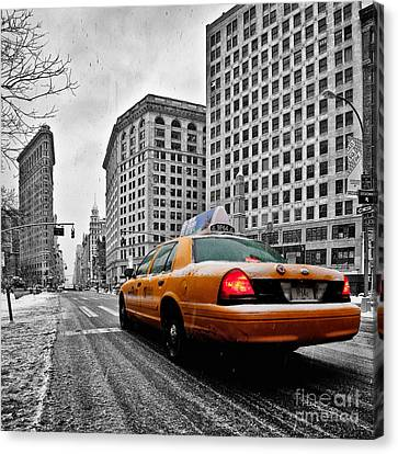 Colour Popped Nyc Cab In Front Of The Flat Iron Building  Canvas Print by John Farnan
