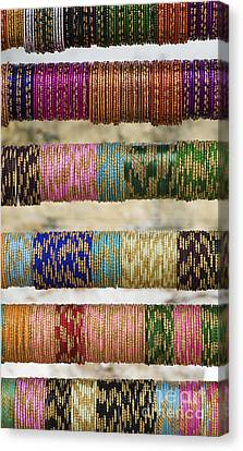 Coloured Glass Indian Bangles Canvas Print by Tim Gainey